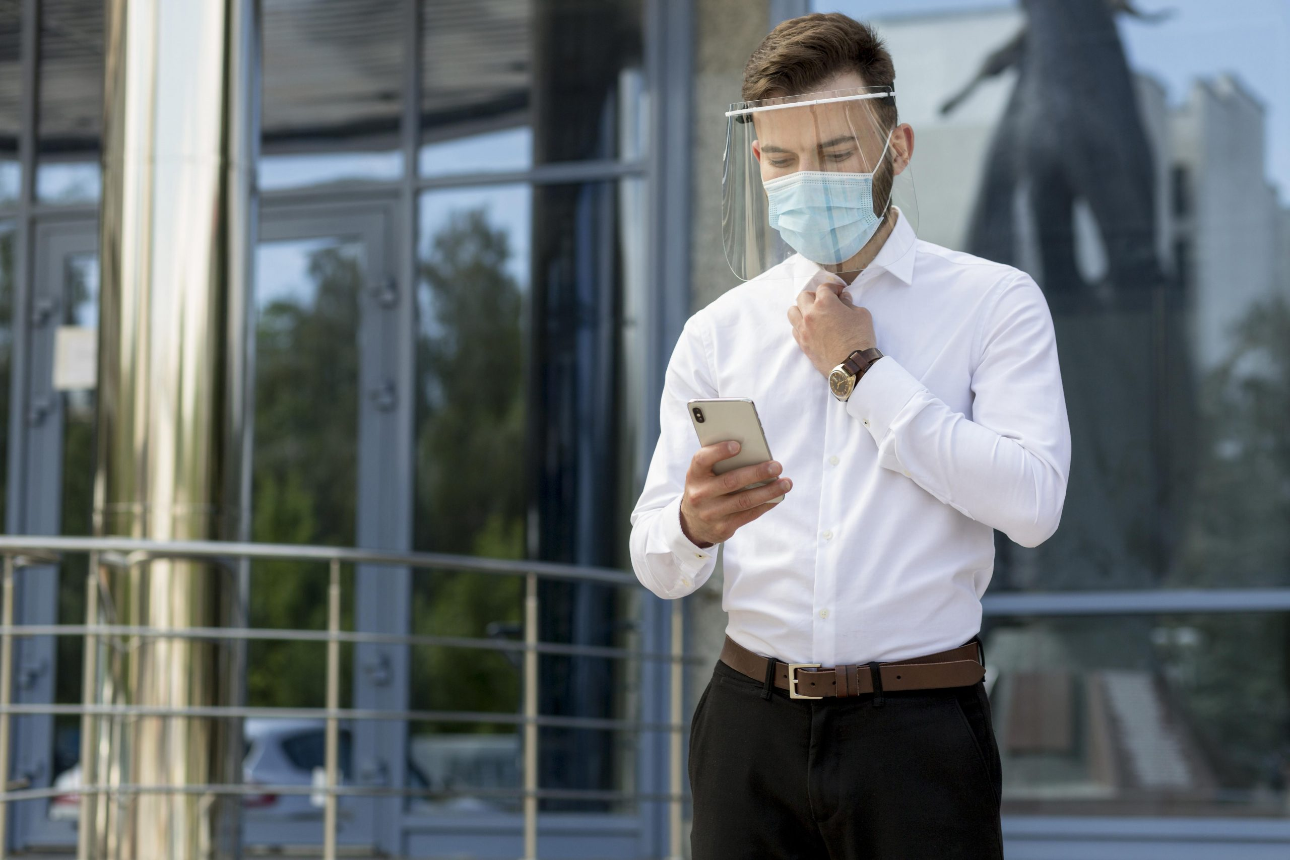 man-with-mask-using-mobile